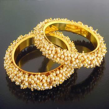 Gold pearl bangles and bracelets