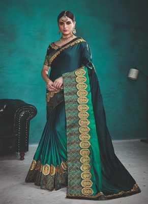 Dark teal embroidered silk blend saree with blouse