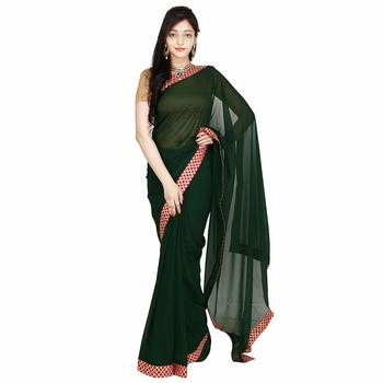 green plain georgette saree with blouse