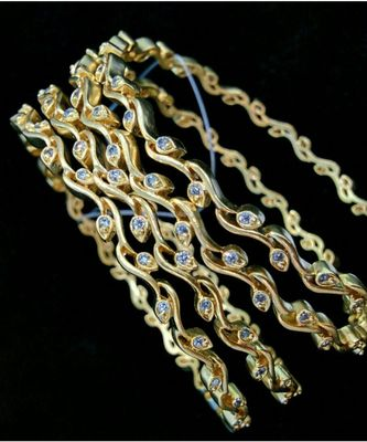 Georgeous High Gold Plated Bangle With American Diamond Stones