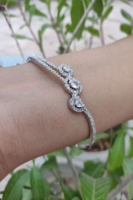 Silver and White Bracelets