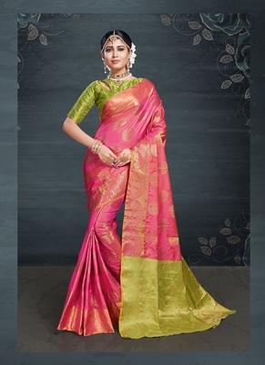 Pink woven banarasi silk saree with blouse