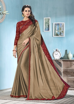 Beige embroidered chiffon saree with blouse