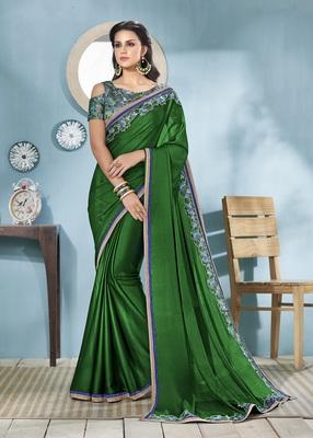 Dark green embroidered silk saree with blouse