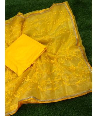 Yellow woven net saree with blouse