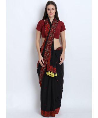 Black Cotton Malmal Saree With Hand Embroidered Mirror & Multiple Design Ajrakh Border & Fancy Tessels on Pallu
