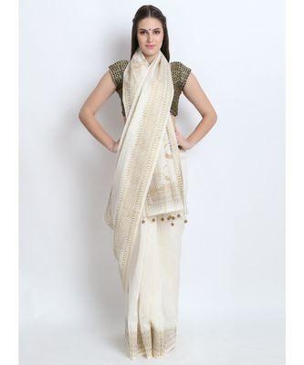 Off White Hand Block Printed Silk Chanderi Saree With Traditional Nath Design & Golden Tessels On Pallu