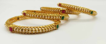Gold   beaded jewellery bangles