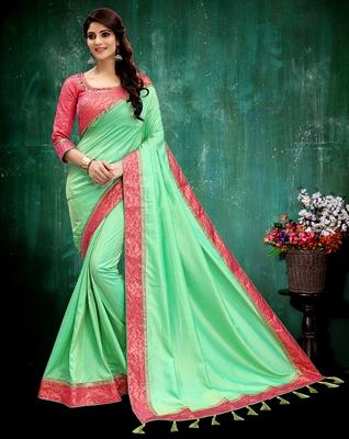 Light green plain silk saree with blouse