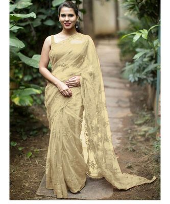 Cream woven net saree with blouse