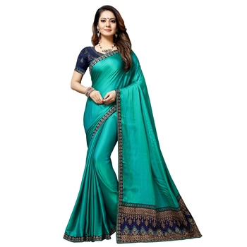 Dark turquoise embroidered silk blend saree with blouse