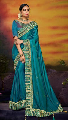 Dark sky blue embroidered satin saree with blouse