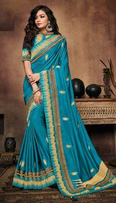 Aqua blue embroidered satin saree with blouse
