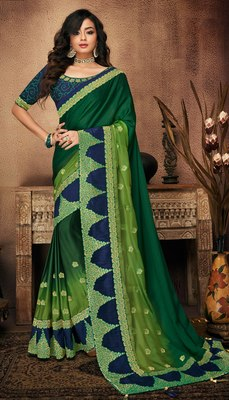 Dark green embroidered satin saree with blouse