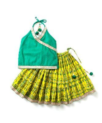 Printed yellow Lehenga with green halter neck choli