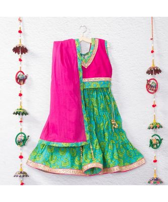 Printed green lehenga with pink tie back crop top and a beautiful pink dupatta