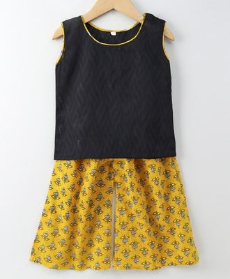 Printed yellow Palazzo with a self print Black top with attached sleeves