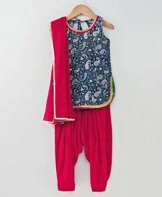 printed blue short top with pom pom and contrast red semi patiala and red cotton dupatta