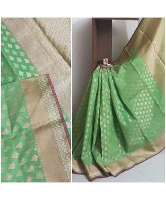 Green banarasi brocade woven saree with blouse