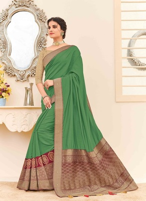 dark olive woven silk blend saree with blouse
