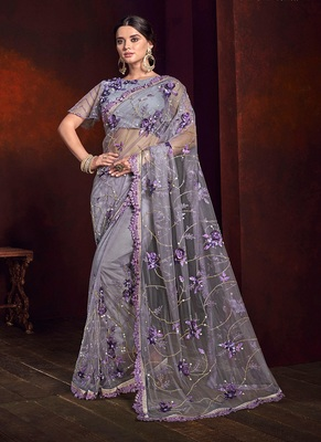 Lilac embroidered net saree with blouse