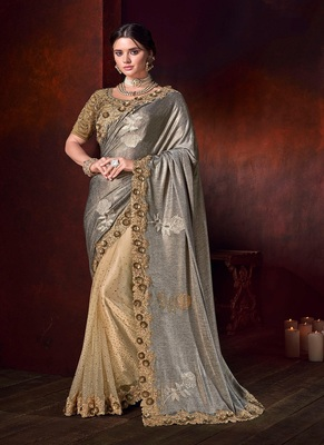 Golden embroidered fancy fabric saree with blouse