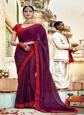 dark magenta embroidered georgette saree with blouse