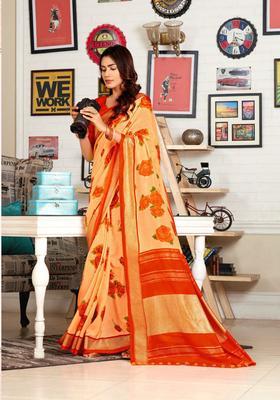 Orange woven jute saree with blouse