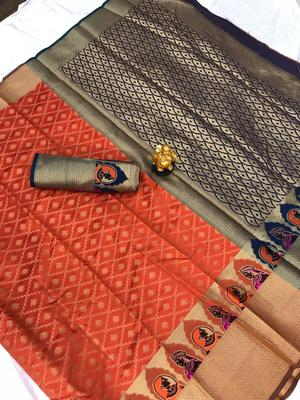 orange woven Kanjivarm Silk Saree With Attached Blouse