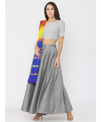 grey lenin blouse paired with silk skirt and blue shibori duppatta