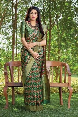 Dark green woven banarasi silk saree with blouse