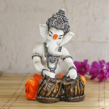 Lord Ganesha playing Tabla