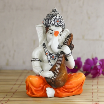 Lord Ganesha playing Guitar Decorative Showpiece