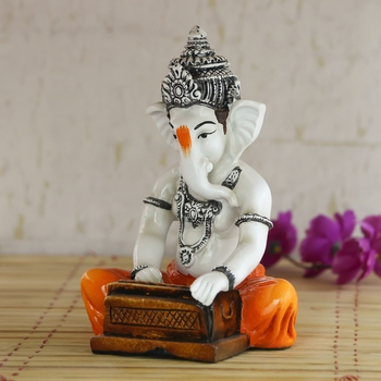 Lord Ganesha playing Harmonium Decorative Showpiece