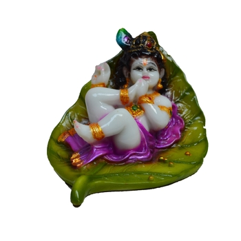 Synthetic Laddu Gopal on Green Leaf
