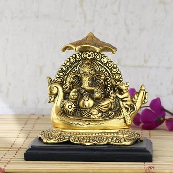 Golden Lord Ganesha sitting on Swan Throne