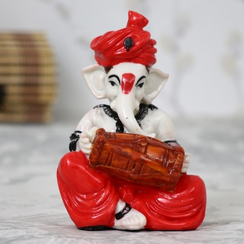 Lord Ganesha playing Dholak