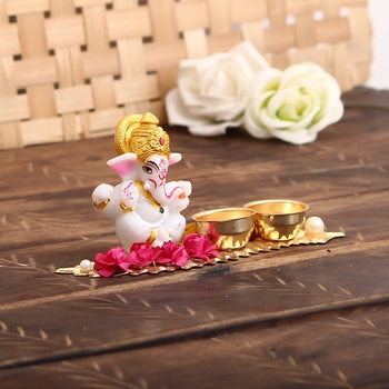 Lord Ganesha Idol on Decorative Leaf with 2 holders for auspicious offerings