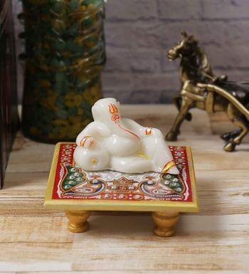 Lord Ganesha resting on Marble Chowki