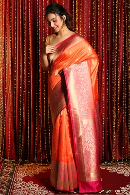 Orange woven tussar silk saree with blouse
