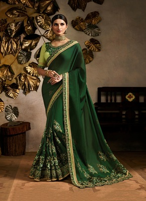 dark green embroidered silk saree with blouse