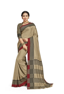 Beige printed tussar silk saree with blouse