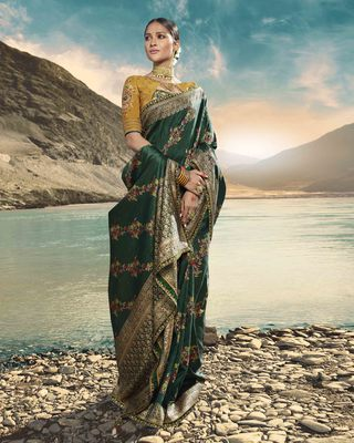Dark green embroidered raw silk saree with blouse