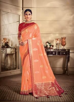 Peach woven silk blend saree with blouse