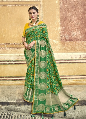 Green embroidered patola saree with blouse