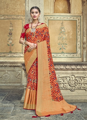 Peach embroidered patola saree with blouse
