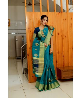 teal woven raw silk saree with blouse