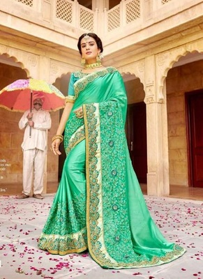 sea green embroidered fancy fabric saree with blouse