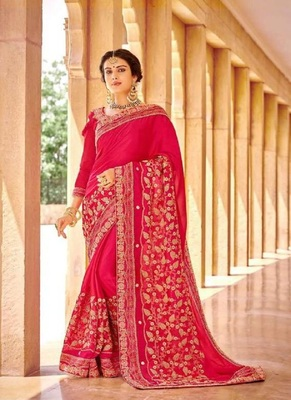 Magenta embroidered fancy fabric saree with blouse