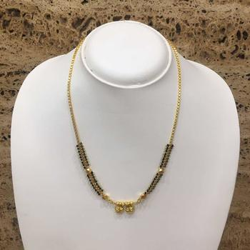 Women's Alloy Single Line Mangalsutra with Black Beads and Gold Chain Golden Plated Design Vati  Pendant
